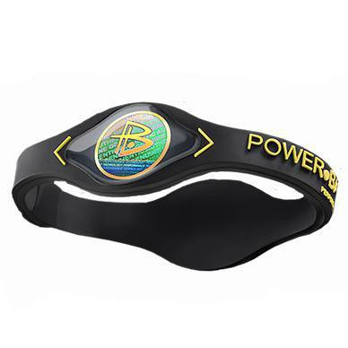 power balance wristband black with yellow lettering. Black Bedroom Furniture Sets. Home Design Ideas