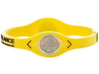 power balance wristband yellow with black lettering. Black Bedroom Furniture Sets. Home Design Ideas